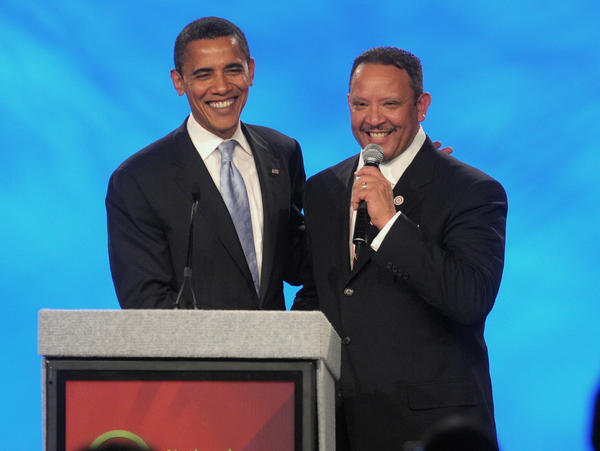 Then-presidential candidate Barack Obama poses with National Urban League President Marc Morial on Aug. 2, 2008.