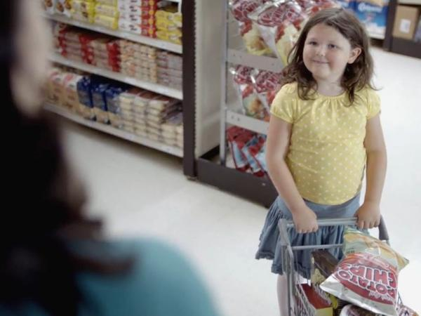 A controversial ad by Blue Cross and Blue Shield of Minnesota shows an overweight shopper and her daughter buying junk food.