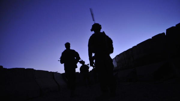 U.S. troops from the 2nd Battalion, 87th Infantry Regiment patrol at dawn in Kandalay, Afghanistan on Aug. 4, 2011. A worldwide stand down for troops to take part in suicide prevention training Thursday is part of the Army's response to an alarming suicide rate of nearly one per day.