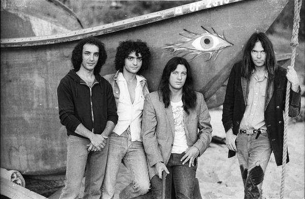 "With Crazy Horse, left to right: Ralph Molina, Billy Talbot, Frank ""Poncho"" Sampedro, Neil Young. On Malibu Beach, 1975."
