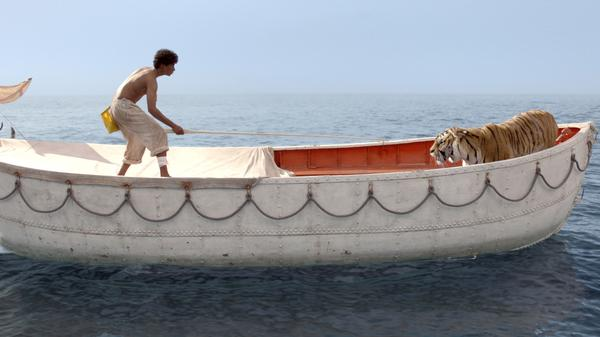Pi Patel (Suraj Sharma) is lost at sea with a fierce Bengal tiger, Richard Parker.