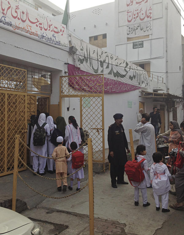 Students file into Lahore's reopened Farooqi Girls High School. The school was temporarily closed after a violent attack in October.