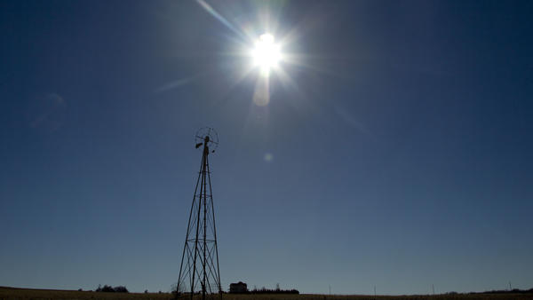 The sun shines above a farm near White City, Kan., in November.
