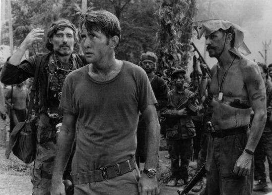 Dennis Hopper, Martin Sheen, and Frederic Forrest survey a temple in a scene from Francis Ford Coppola's <em>Apocalypse Now</em>.