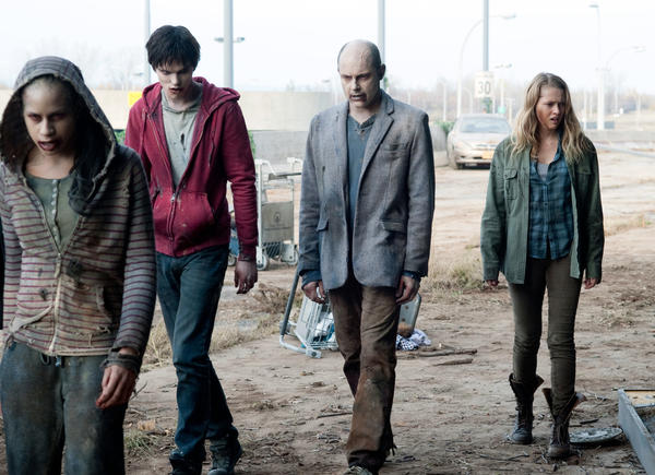 Nicholas Hoult, Rob Corddry and Teresa Palmer lurch through a scene in Levine's zombie romantic comedy.