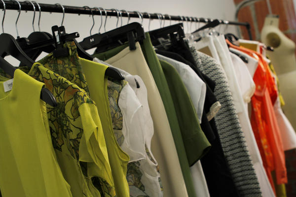 Vosovic's Spring 2013 collection was picked up by 23 new stores. Some of its samples hang on racks inside his studio.