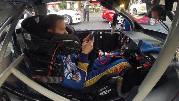 Brad Keselowski looks at his smartphone during a NASCAR champions parade in Las Vegas in November.