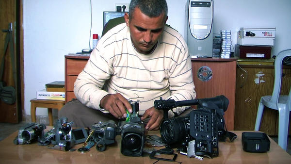 Emad Burnat, a Palestinian who co-directed the Oscar-nominated documentary<em> 5 Broken Cameras</em>, displays the cameras destroyed by Israeli settlers and security forces. The film focuses on a Palestinian village protesting Israel's separation barrier in the West Bank.