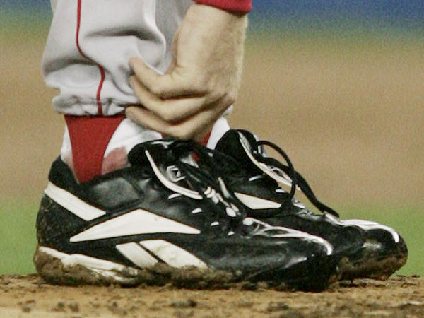Schilling tends to his right ankle during Game 6 of the American League Championship Series against the New York Yankees in 2004.
