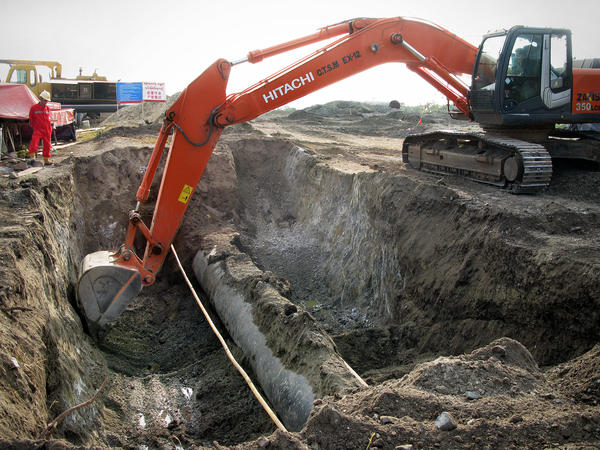 Engineers from China and Myanmar work to bury an oil pipeline outside the Myanmar city of Mandalay. Chinese media reports say the 700-mile-long oil and gas pipelines will be completed in May.