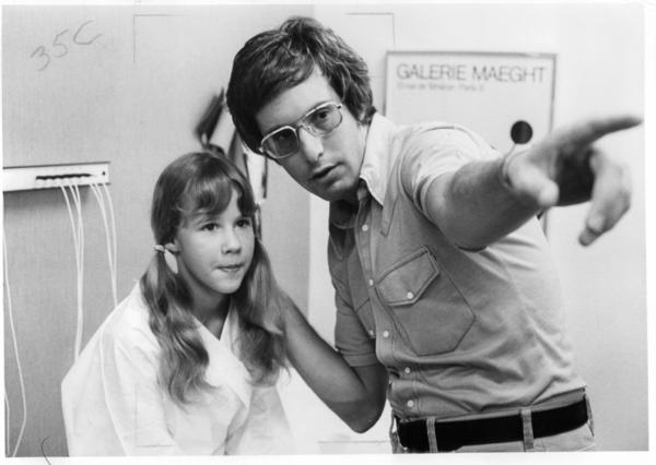 Friedkin gives direction to 12-year-old actress Linda Blair, who played the possessed Regan MacNeil, on the set of <em>The Exorcist</em>.