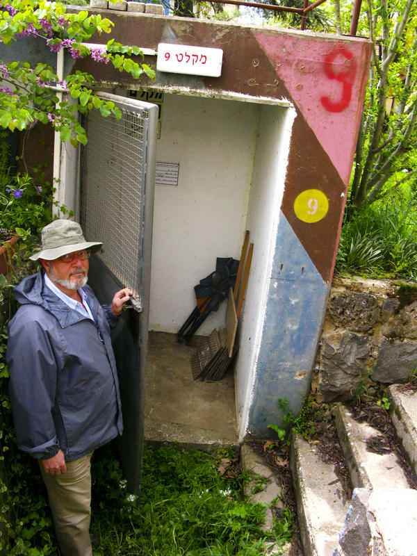 Nadav Katz shows the entrance to a bomb shelter on the kibbutz where he lives in the Israeli-occupied Golan Heights. The war in Syria has kibbutz members double-checking to make sure the shelters are ready to go.