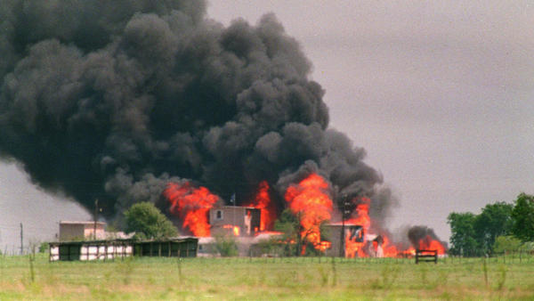 Flames engulf the Branch Davidian compound in Waco, Texas, on April 20, 1993. A 51-day standoff at the compound ended in a fire and the deaths of about 80 sect members, including two dozen children.