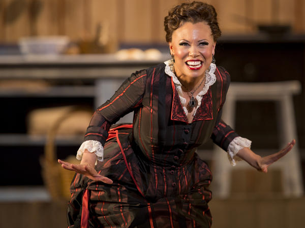 "When she's discovered to be a multiracial woman ""passing"" as white, the Cotton Blossom's star performer, Julie (Alyson Cambridge), is forced to leave the company."