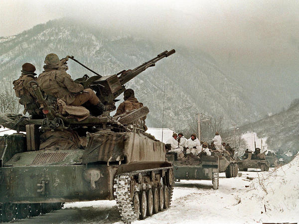 Russian soldiers take their position near the village of Shatoy, Chechnya.