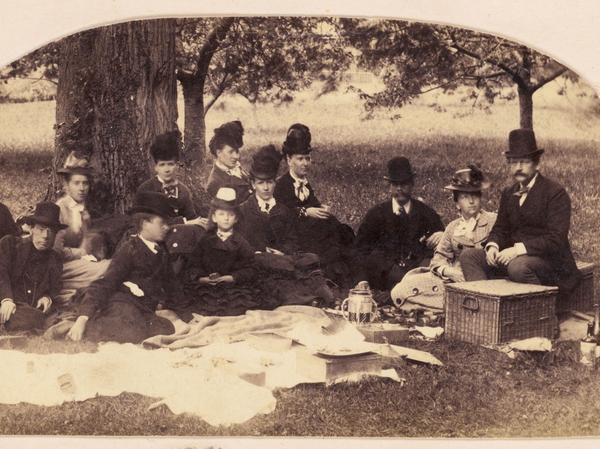 "A family enjoys a picnic in the countryside in 1869. Food historian Lynne Olver says middle-class Victorians picnicked on a tablecloth or bedspread like we do today. ""The wealthier you were, the higher you dined,"" she says."