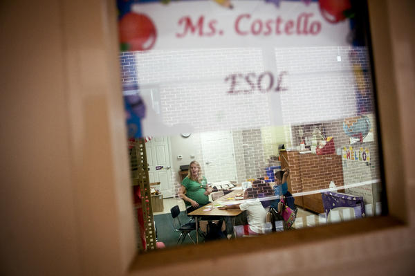 Costello teaches English as a second language to children in a suburban Washington school district.