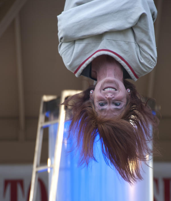 Kristen Johnson as Lady Houdini in an upside-down escape.