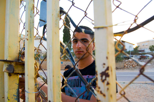 A decade ago, Israel's separation barrier cut off Ishaq Amer's home from its Palestinian village.
