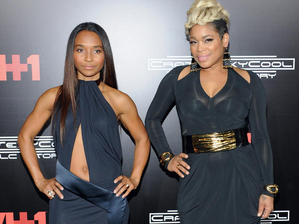 TLC's Chilli and T-Boz attend the New York premiere of <em>CrazySexyCool</em> on Oct. 15, 2013.