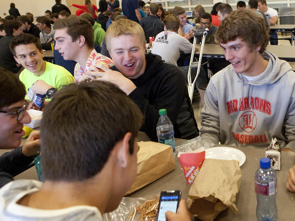 Students at Lowell High School in Michigan sit down for lunch. Shorter lunch breaks mean that many kids don't get enough time to eat and socialize.