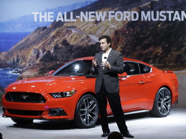 Mark Fields, chief operating officer for Ford Motor Company, unveils the automaker's new 2015 Ford Mustang in Dearborn, Mich., on Dec. 5.