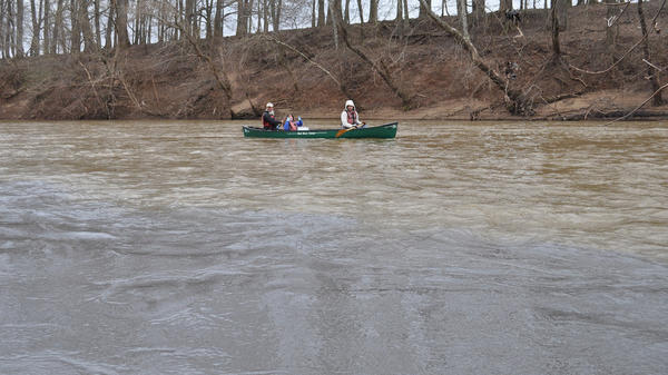 Volunteers with the Dan River Basin Association, graduate students from Duke University and staff with the environmental group Appalachian Voices collect water samples on the Dan River after a massive coal ash spill.