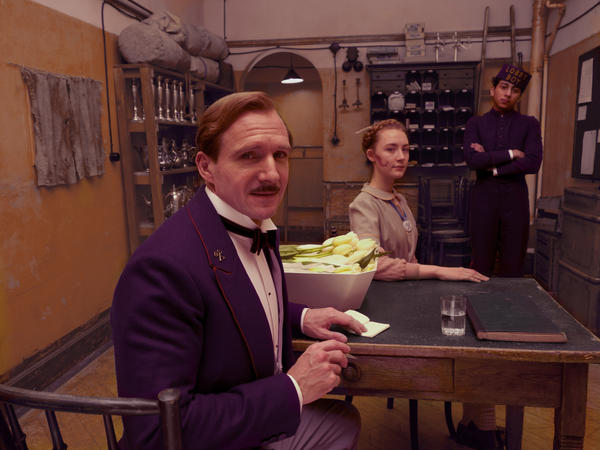 Ralph Fiennes portrays concierge Monsieur Gustave in <em>The Grand Budapest Hotel, </em>the actor' first project with director Wes Anderson.