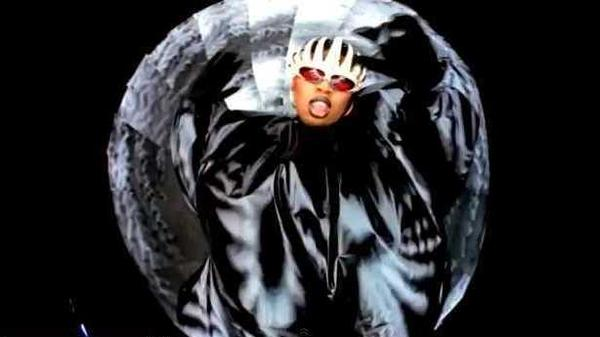 "June Ambrose designed the black suit seen in this screenshot from Missy Elliott's highly praised music video for ""The Rain."""