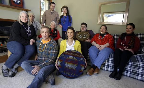 Some of the 79 people told by the Confederated Tribes of Grande Ronde that they were enrolled in error. Seated on the floor are Russell Wilkinson (left) and Mia Prickett. Seated second row (from left) are Nina Portwood-Shields, Jade Unger, Marilyn Portwood, Eric Bernando, Debi Anderson and Val Alexander. Standing are Antoine Auger (left) and Erin Bernando.