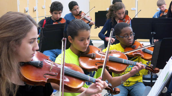Students participate in orchestra practice at Dr. John Folks Middle School in suburban San Antonio. The school is brand new and was built with explosive growth in mind — the student population is expected to double to 1,200 within five years.