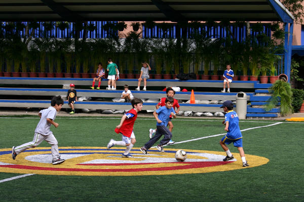 The author's son (center, in the red jersey) playing soccer in Mexico City.