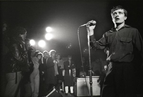 "Singer Ian Curtis on stage in 1980 with Joy Division, whose song ""Transmission"" is among those explored in Greil Marcus' book <em>The History of Rock 'N' Roll in Ten Songs.</em>"