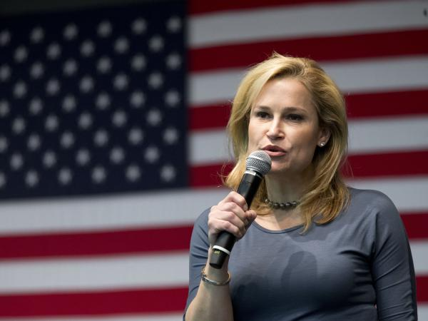 Heidi Cruz, wife of Republican presidential candidate, Sen. Ted Cruz, R-Texas, introduces him during a town hall meeting on Friday, in Wilton, Iowa.