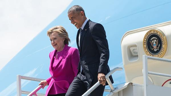 President Obama and Democratic presidential candidate Hillary Clinton walk off Air Force One in Charlotte, N.C., to attend a Clinton campaign event.