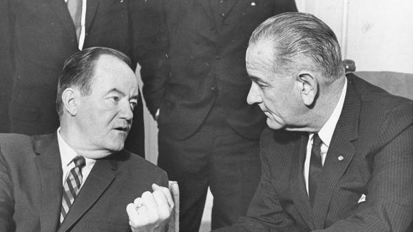 President Lyndon B. Johnson (right) listens to Vice President Hubert H. Humphrey's report of his five-day Far East tour, Jan. 3, 1966.