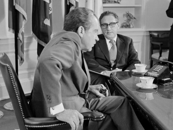 "President Nixon meets Secretary of State Henry Kissinger in the Oval Office of the White House on Oct. 9, 1973. Days before the 1972 election, Kissinger declared that peace was ""at hand"" in Vietnam."