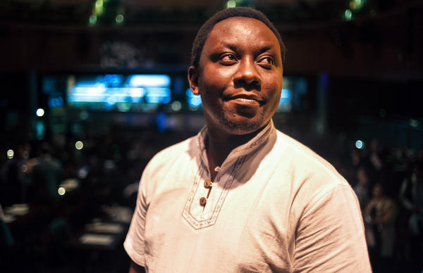 Dr. Thumbi Mwangi, an infectious disease epidemiologist from Kenya, at Howard Theatre in Washington, DC, on Nov. 29, 2016. In the U.S., Mwangi worked on a vaccine for cows that aimed to combat the same disease he saw the bovine battle in Kenya as a kid.