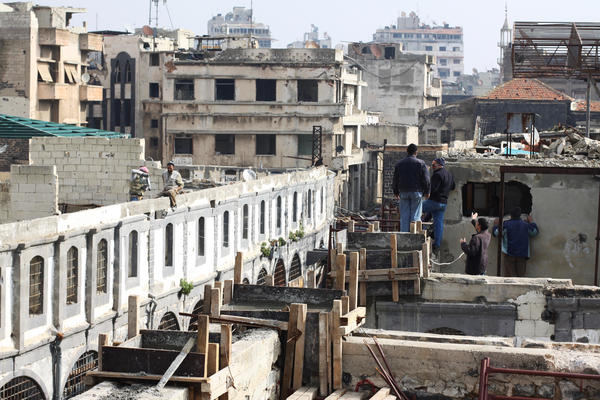 The fighting in Homs has been largely over since 2014 — government forces and their allies crushed the rebels and negotiated surrenders. Now, the United Nations Development Programme is working to rehabilitate the old city. Here, men work on the old souk.
