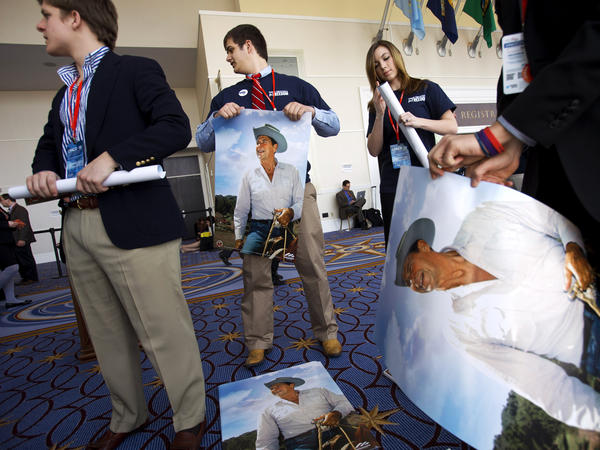 Members of the college group Young Americans for Freedom roll up Ronald Reagan posters to hand out at CPAC in National Harbor, Md., in 2013.