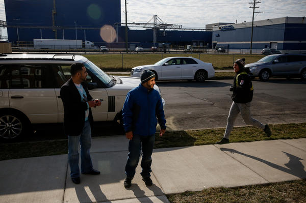 Nabil Nagi and Yunus Wasel outside the Hadwans' home in Hamtramck, Mich.