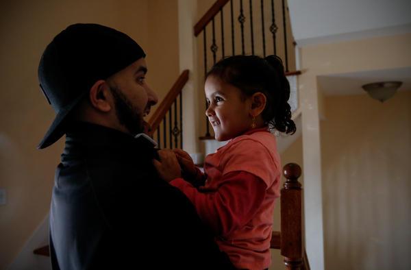 Salah Hadwan and his niece Reema, 3, at home.
