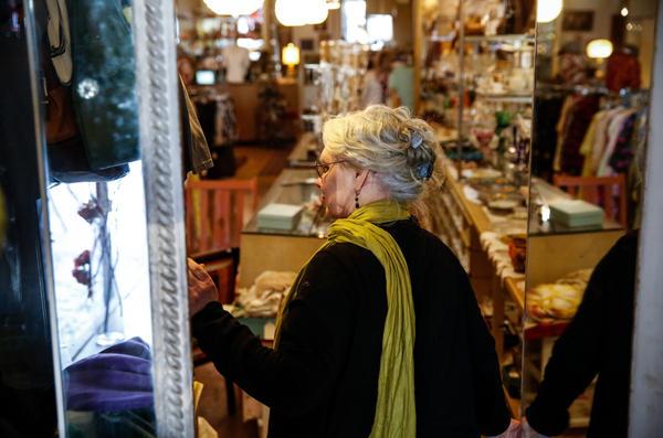 Hamtramck Mayor Karen Majewski looks into her store, Tekla Vintage, located downtown.