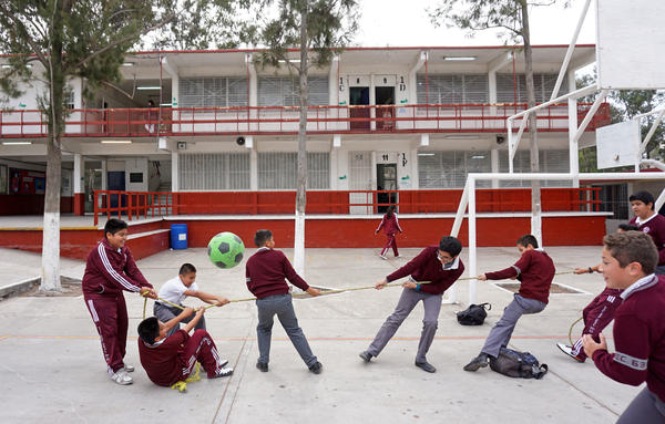 Students play during recess at the Eucario Zavala Secondario 63 school in Tijuana.