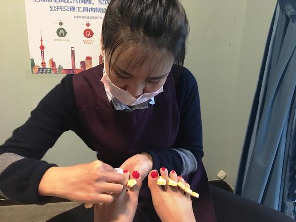 Shanghai pedicurist Ju-wen Zu and NPR's Aarti Shahani talk, aided by a translation app that may change the way we travel abroad forever.