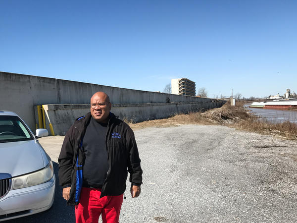 Pastor and community activist Phillip Matthews stands by a levee that protects the town from the Ohio River. Matthews says he's watched for 40 years as Cairo declined, battling outside economic forces, corruption and racial tension.