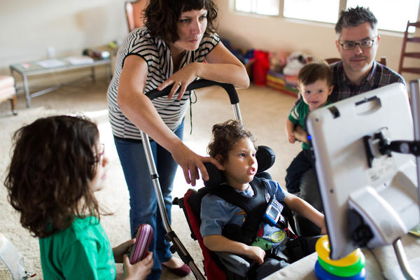 "Gideon, 3, communicates with his parents Kathleen Muldoon and Seth Dobson, his sister Genevieve and brother Cormac, using an electronic device they call, ""Gideon's talker."""