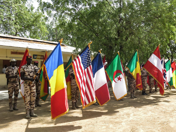 Flag-carrying Chadian soldiers on parade at the closing ceremony in Ndjamena, Chad of Flintlock 2017, US military-led counterterrorism exercises involving forces from 27 countries in 7 locations across west and north Africa.