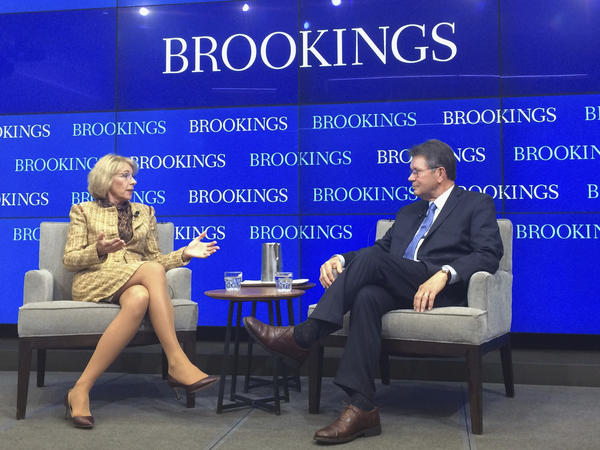 "Education Secretary Betsy DeVos talks with Grover ""Russ"" Whitehurst, senior fellow in the Center on Children and Families in the Economic Studies program at the Brookings Institution on Wednesday in Washington."