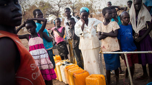 Leya Jogo, in white, was a widowed grade-school teacher in South Sudan before her village was attacked and she ran for her life. Now, like thousands of her neighbors, she spends every day searching for water for herself and her family.